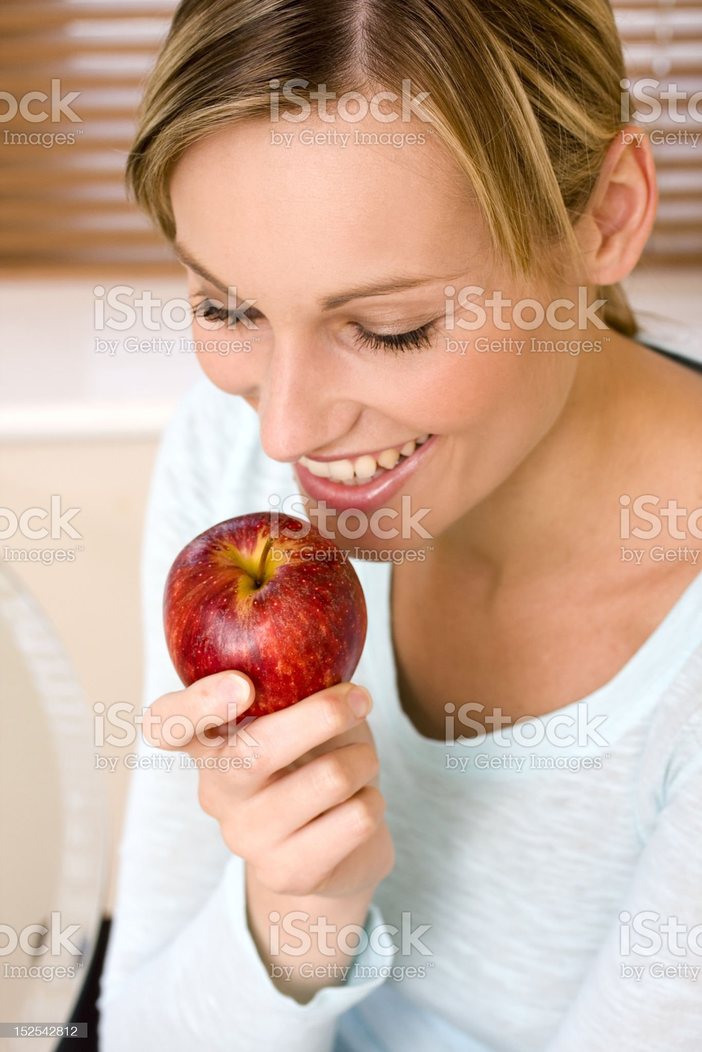 Young Healthy Woman Holding an Apple royalty-free stock photo