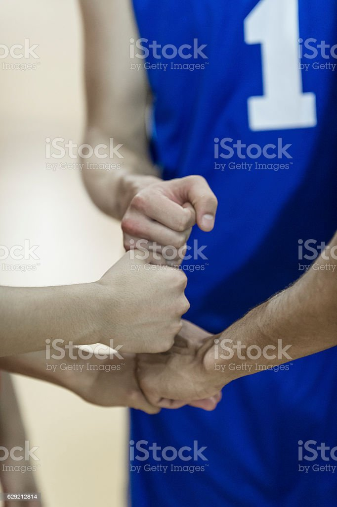 Young high school men fist bumping each other stock photo