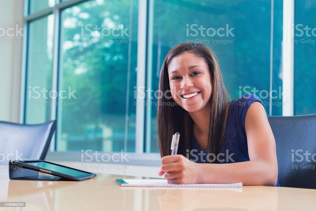 Young high school or college student studying for exam stock photo