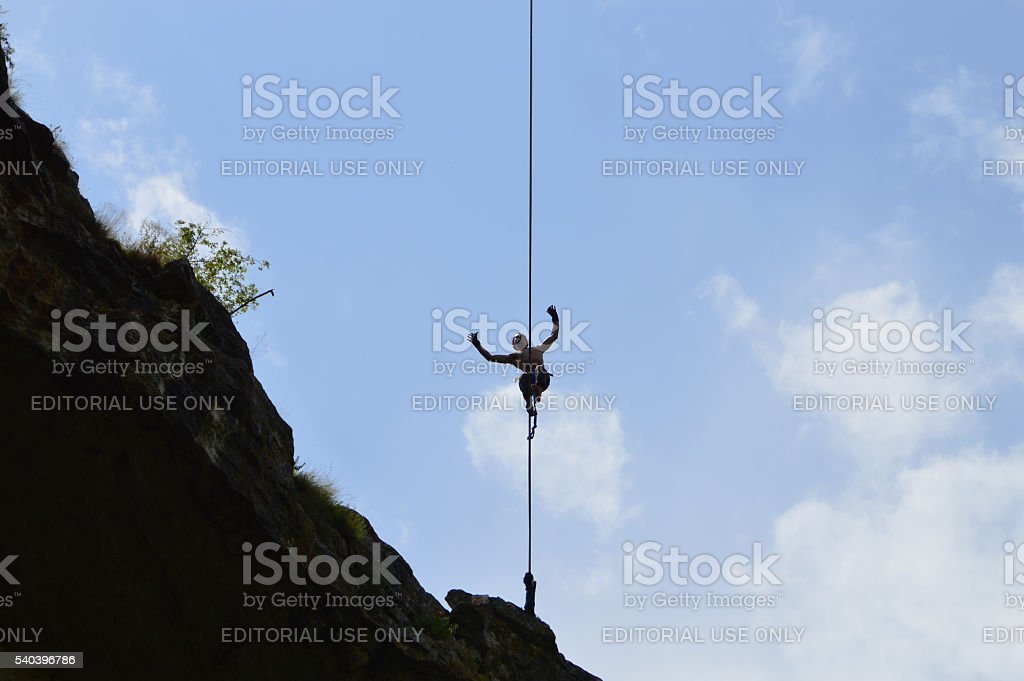Young highline walker on tightrope high in the sky stock photo