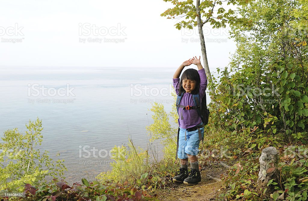 Young Hiker Celebrating stock photo