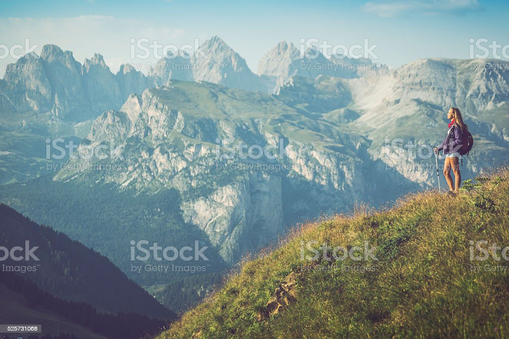 Young hiker girl travel alone on the mountain stock photo