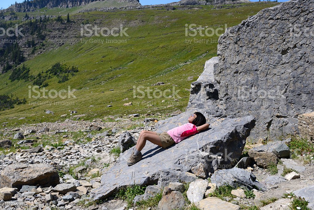 Young Hiker Relaxes in Wilderness royalty-free stock photo