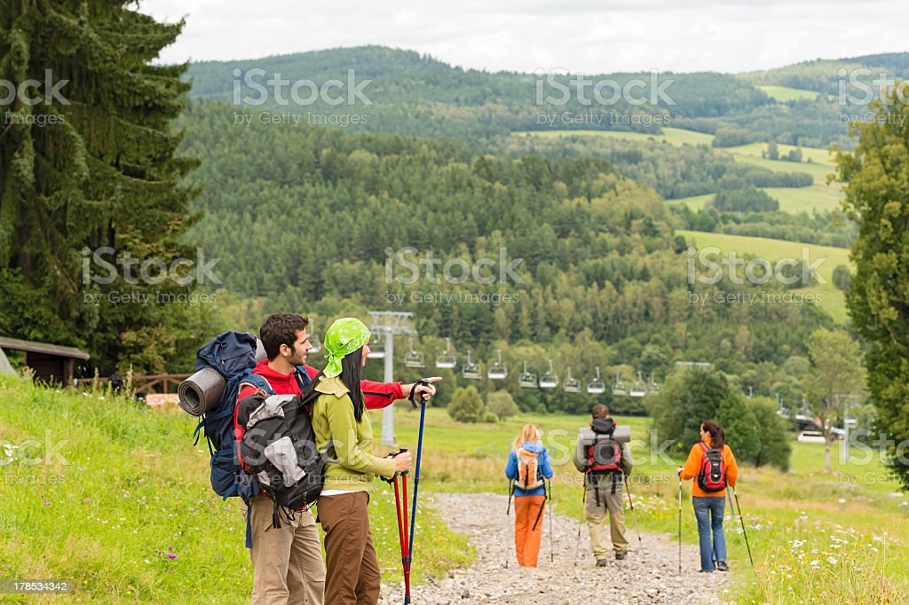 Young hikers enjoying scenic view on mountain royalty-free stock photo