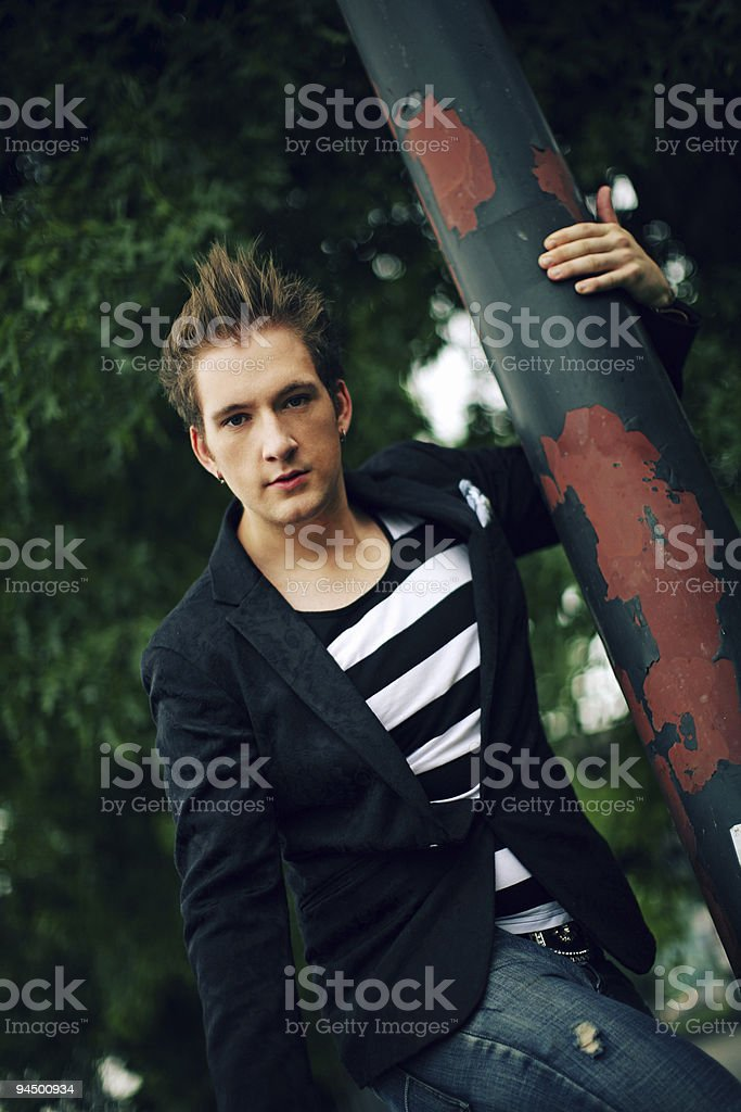 Young Hip Male Leaning Against a Pole royalty-free stock photo