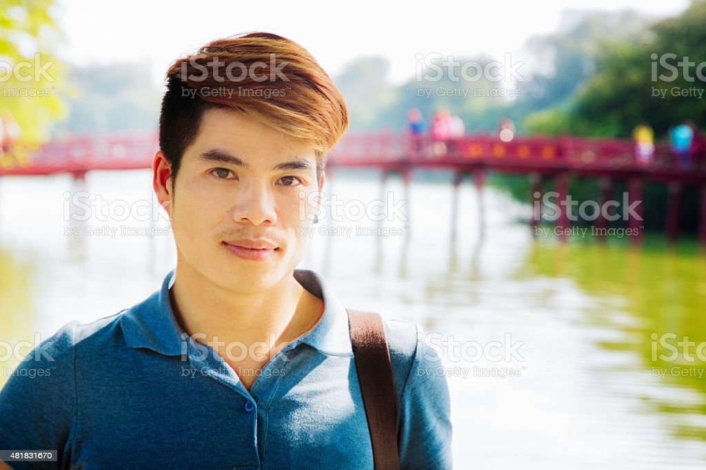 Young hip Vietnamese male serious student portrait Hoan Kiem Hanoi stock photo