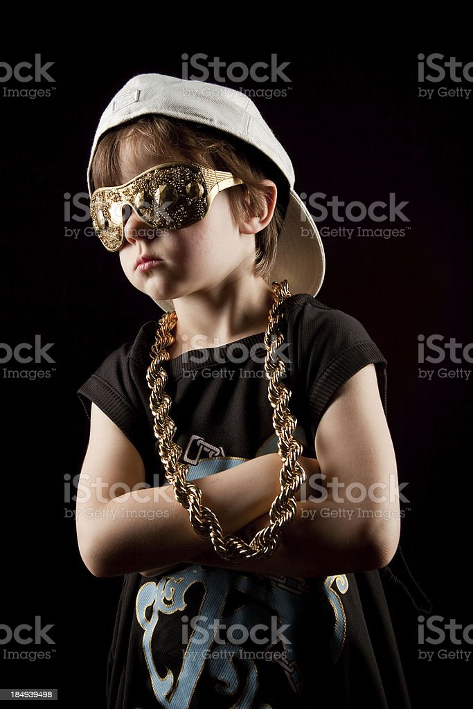 Young Hip-Hop Rapper kid wearing gold chain and hat stock photo