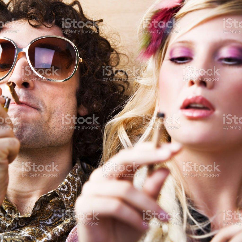 Young Hippie Man and Woman Smoking Marijuana royalty-free stock photo
