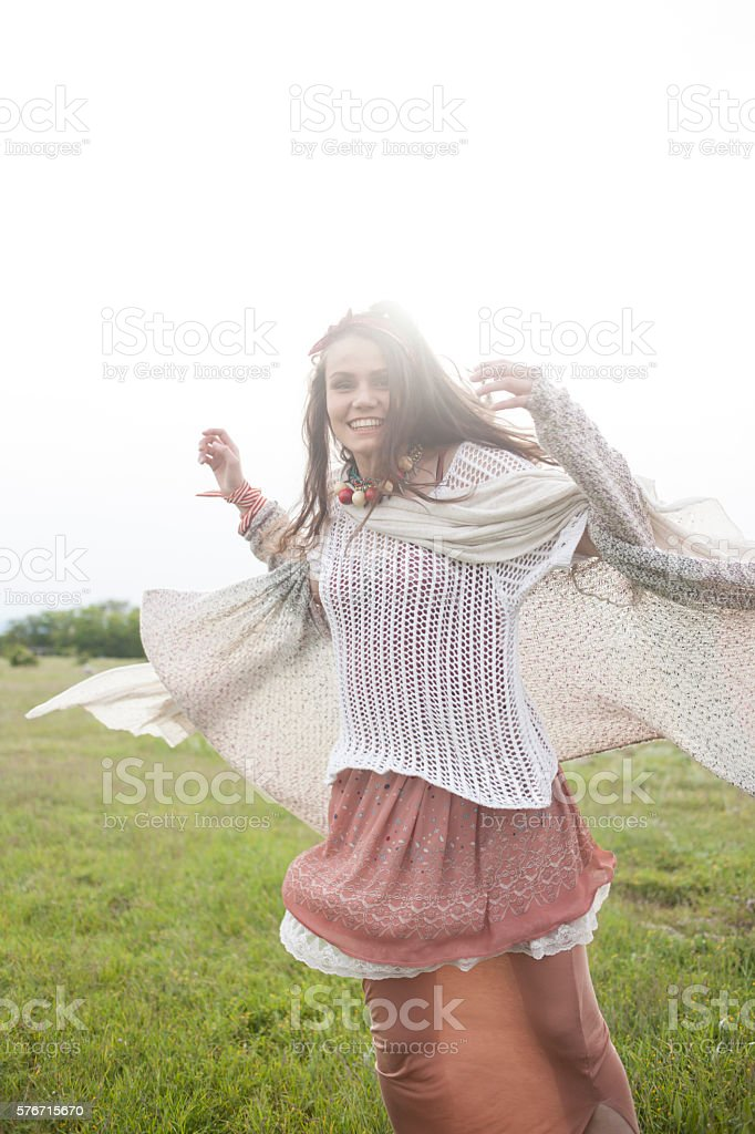 Young hippie woman having fun in the grass stock photo