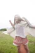 Young hippie woman having fun in the grass
