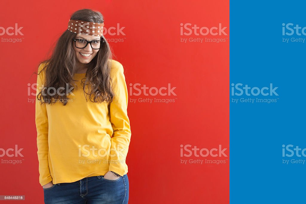 Young hippie woman on red-blue background stock photo