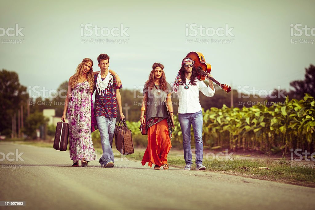Young Hippies walking on the road royalty-free stock photo