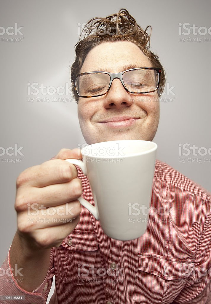 Young hippy drinking morning coffee. stock photo