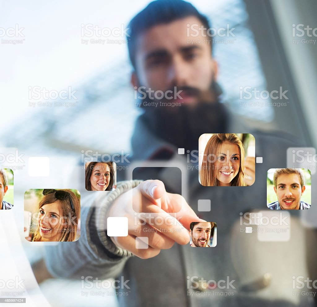 Young Hipster and Monitor Touch stock photo
