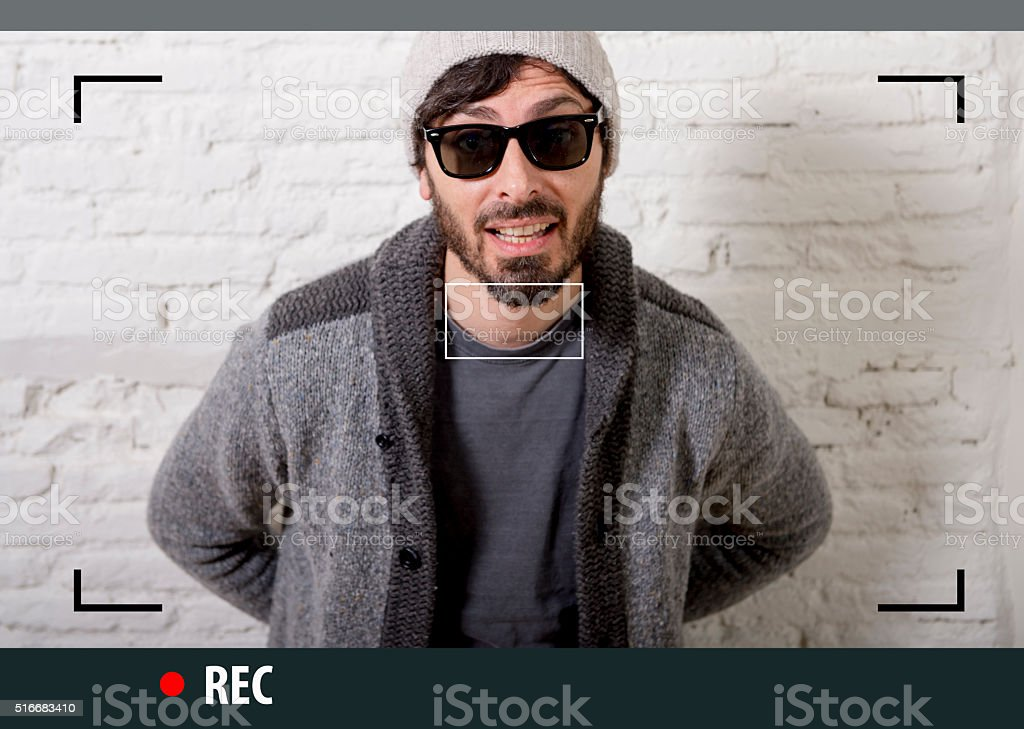 young hipster blogger man recording internet selfie video for blog stock photo