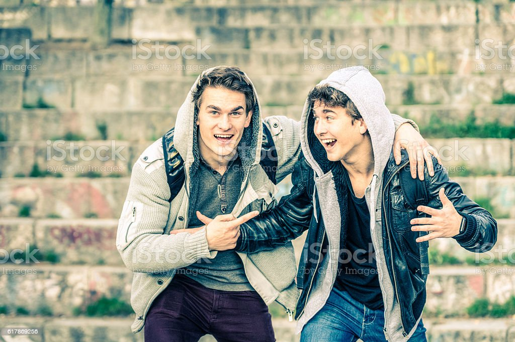 Young hipster brothers best friends having fun together stock photo