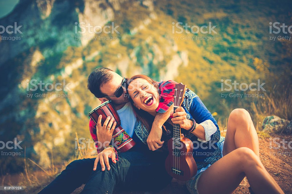 Young hipster couple in the mountains stock photo