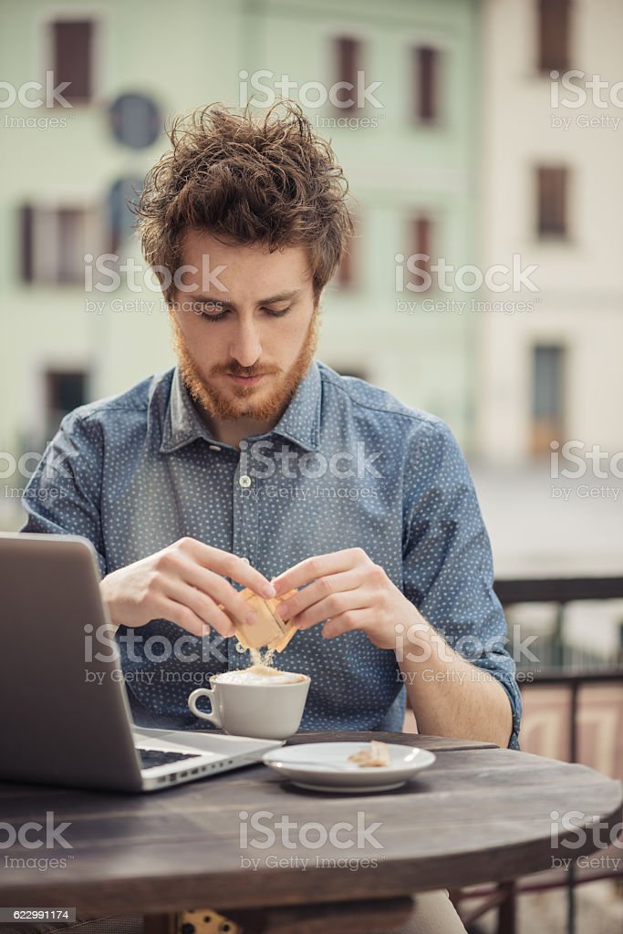 Young hipster having a coffee at the bar stock photo