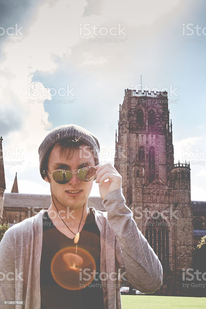 Young Hipster Man in Sunglasses by an Old Church stock photo