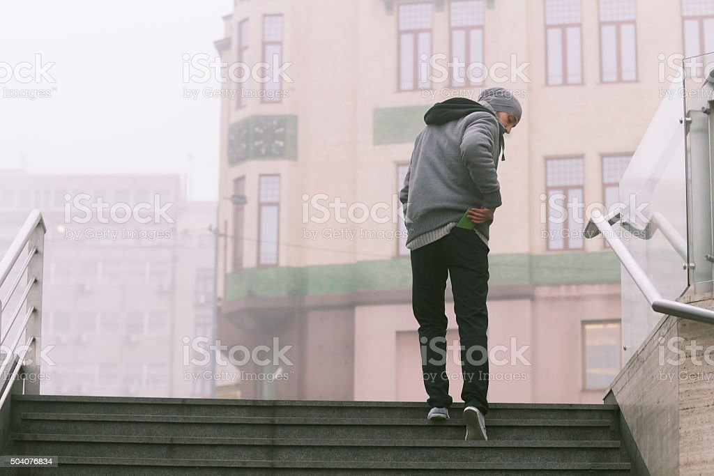 Young hipster man in the city. stock photo