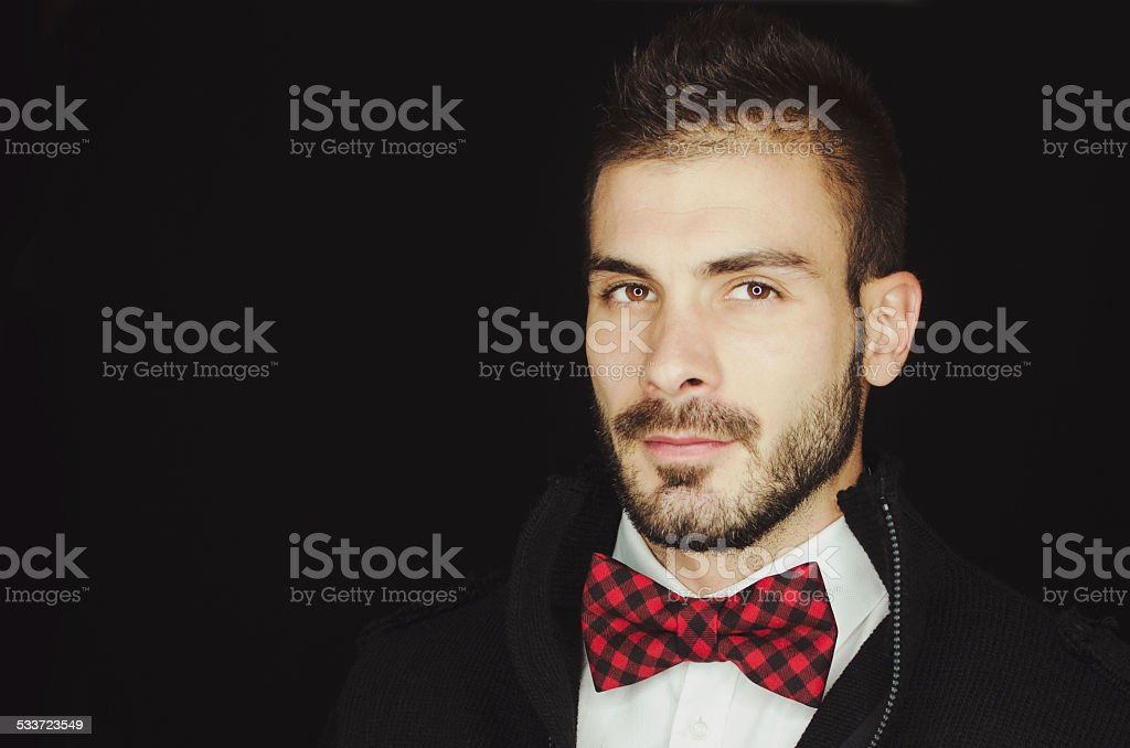 Young hipster man looking at the camera stock photo