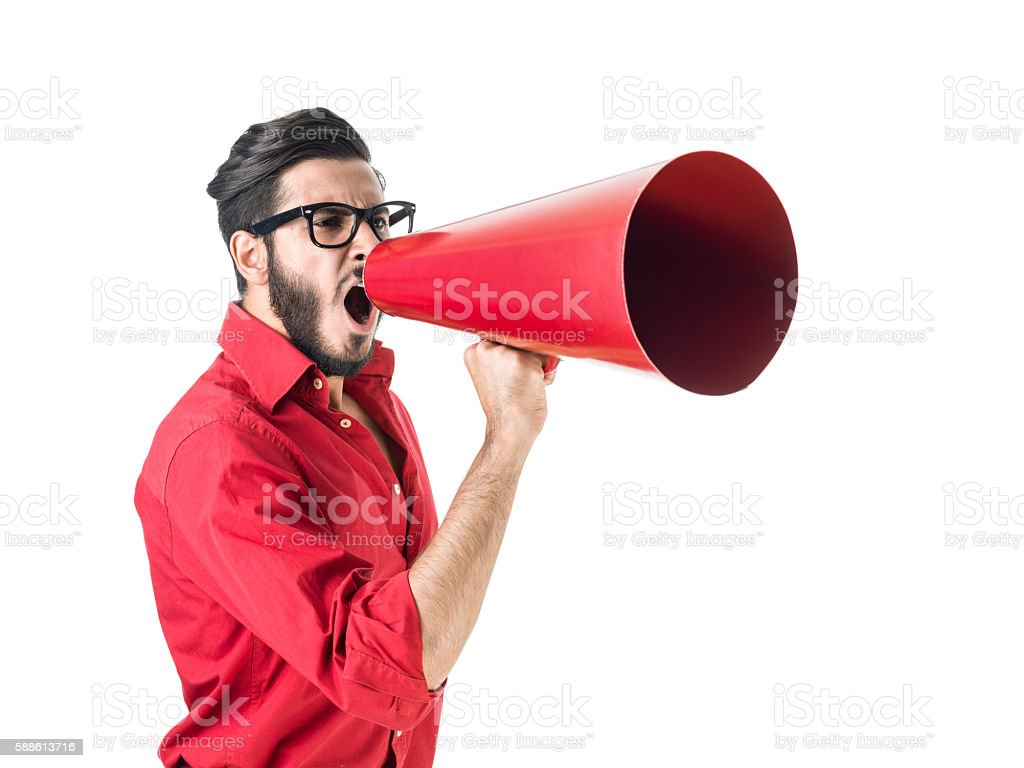 Young Hipster Man Shouting Through Megaphone On White Background stock photo