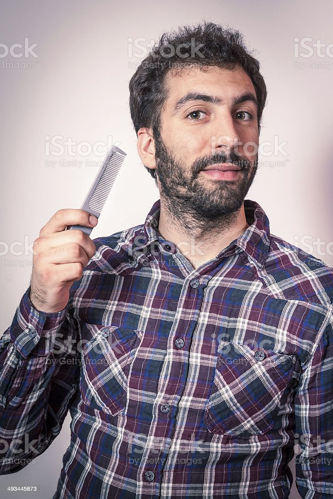 young hipster man want comb his beard and moustaches royalty-free stock photo