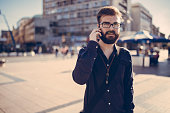 Young Hipster manager with smart phone