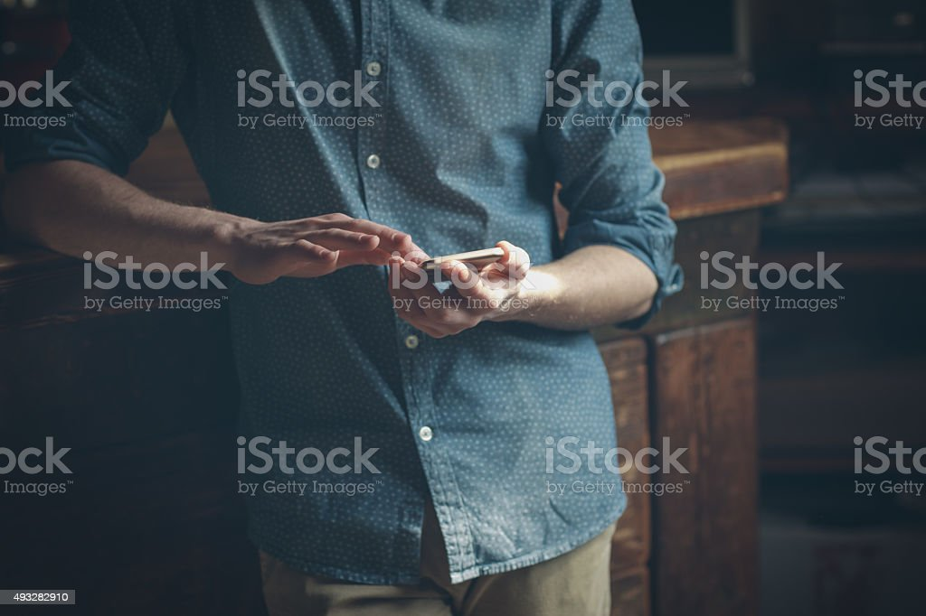 Young hipster using a mobile phone stock photo