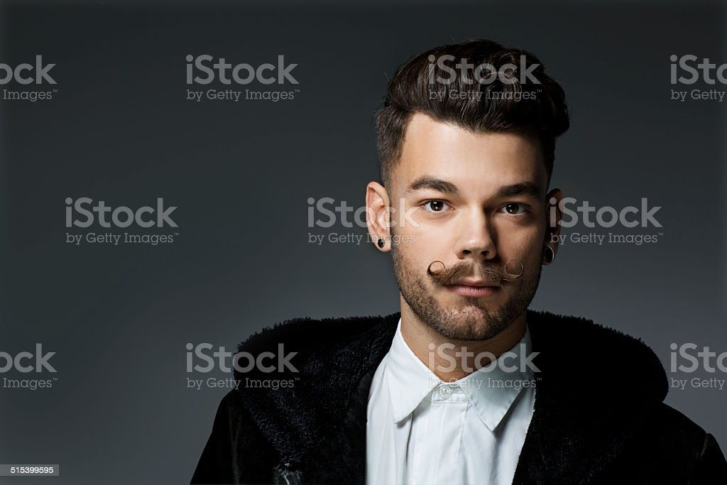 young hipster with long moustaches stock photo