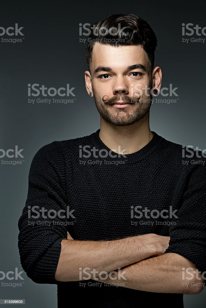 young hipster with moustaches and styled hair stock photo