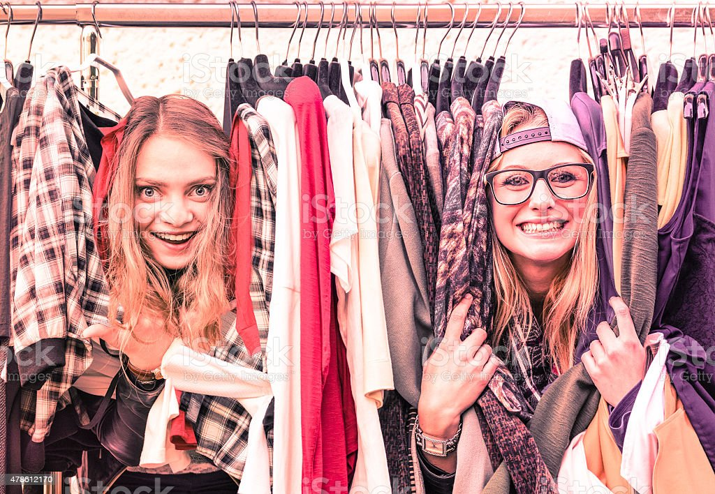 Young hipster women best friends at clothes flea market stock photo