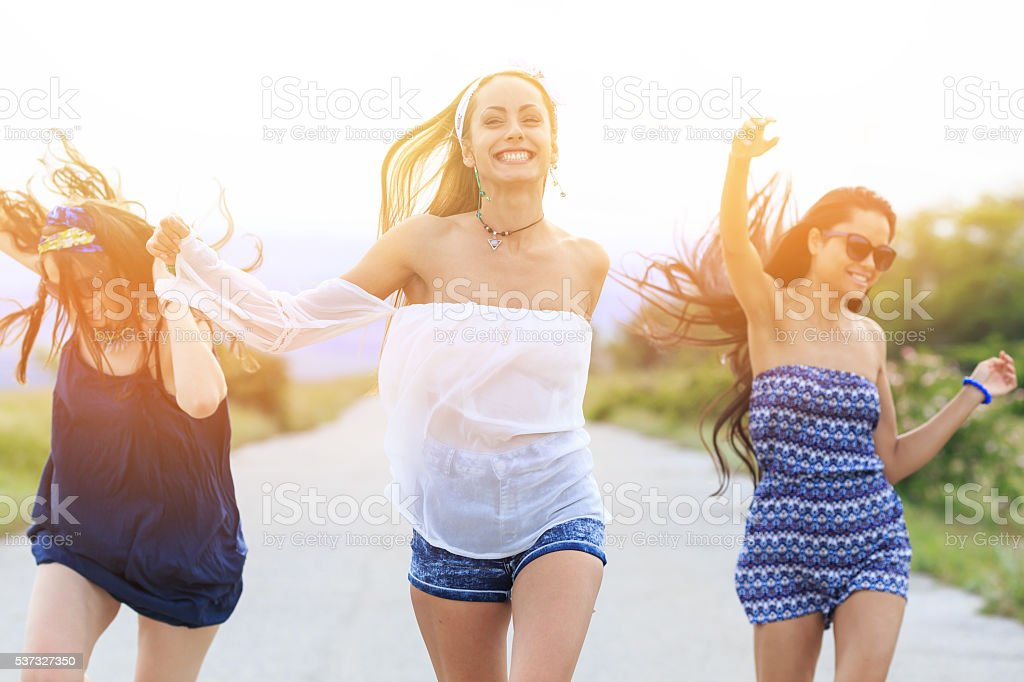 Young hipster women having fun on the road stock photo