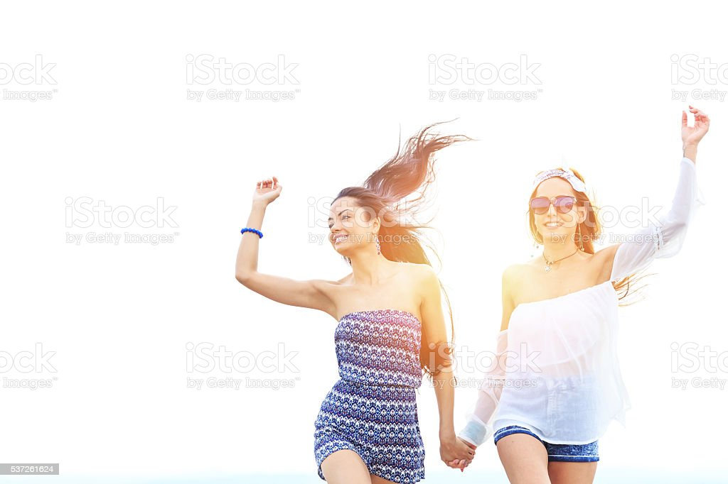 Young hipster women having fun together stock photo