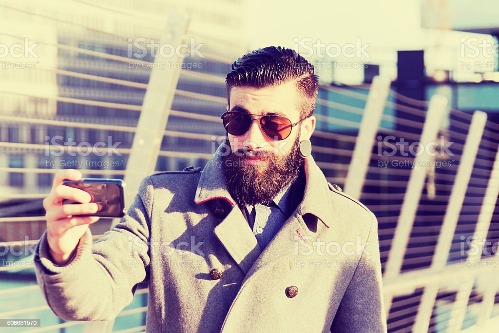 young hipsters businessman take selfie in a modern city stock photo