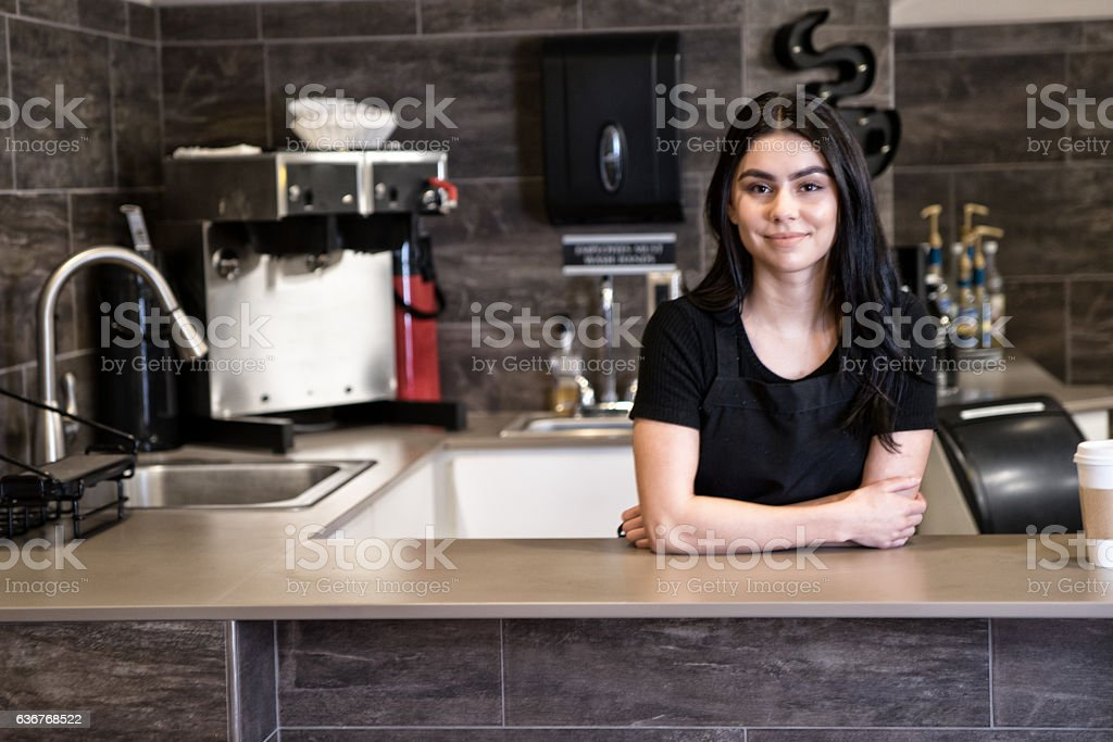 Young Hispanic Barista Posing for Camera stock photo