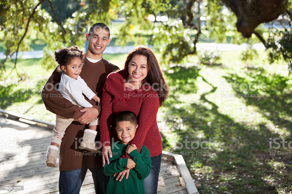 Young hispanic family at park stock photo