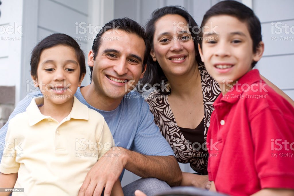 young hispanic family in front of their home royalty-free stock photo