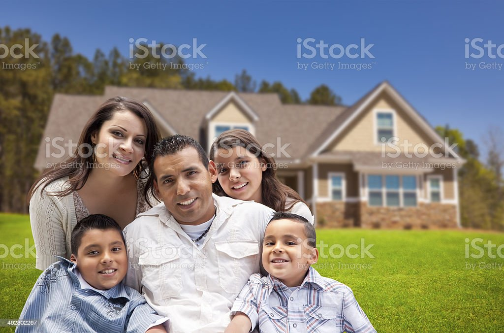 Young Hispanic Family in Front of Their New Home stock photo