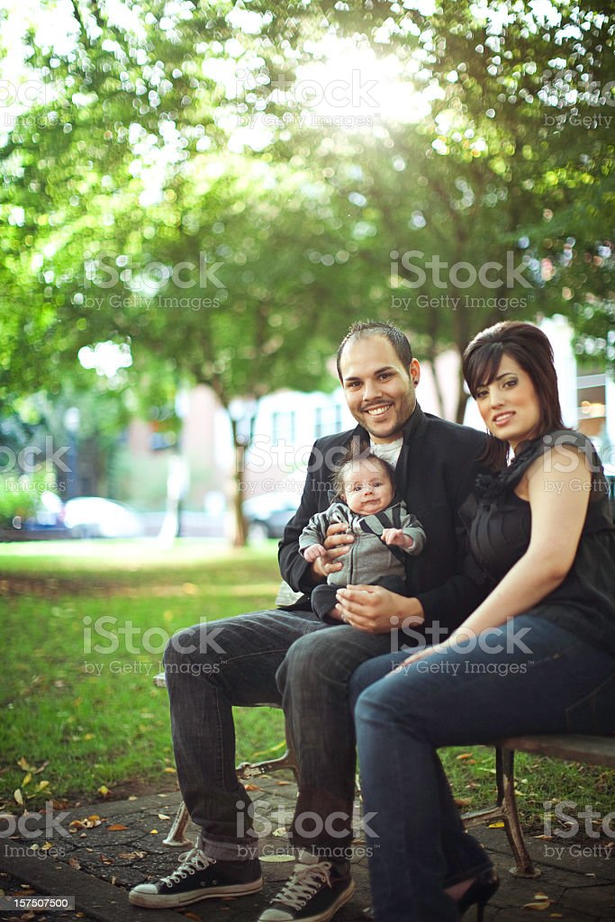 Young Hispanic Family In Urban Park royalty-free stock photo