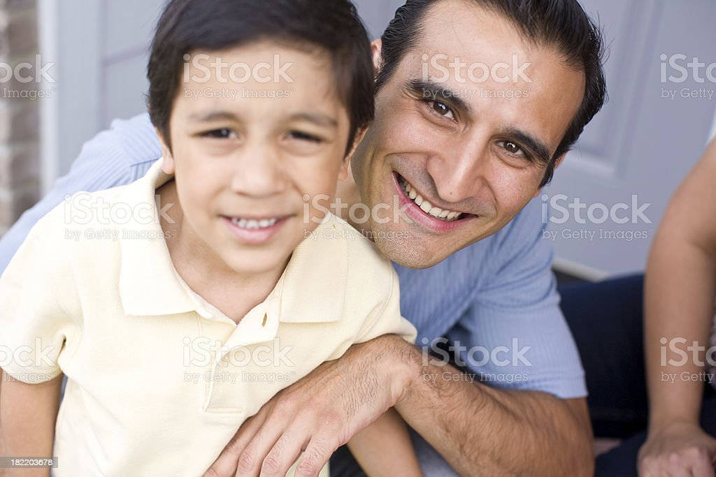young hispanic father with his son royalty-free stock photo