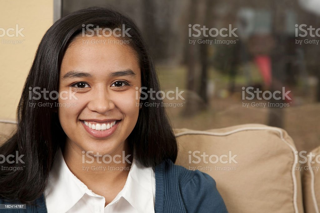 Young Hispanic Girl on the Sofa at Home royalty-free stock photo