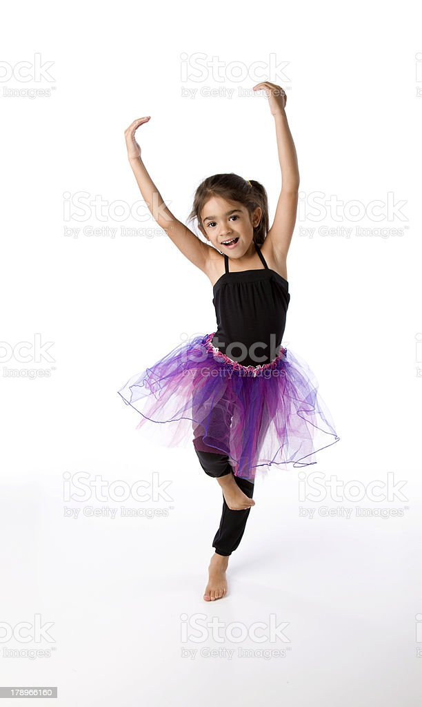 A young Hispanic girl wearing a tutu doing ballet stock photo