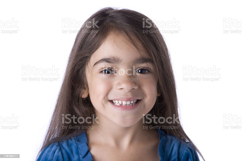 Young Hispanic Girl with a Toothy Smile royalty-free stock photo