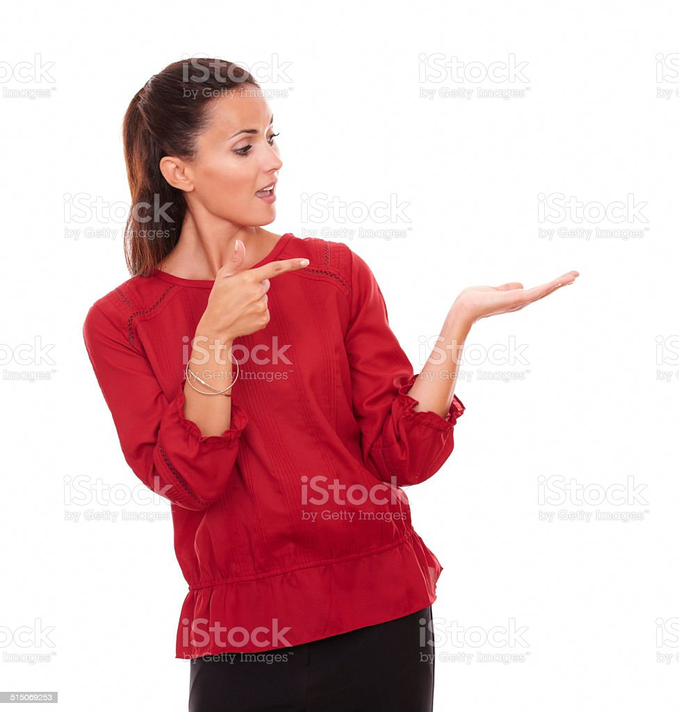 Young hispanic lady holding her left hand up stock photo