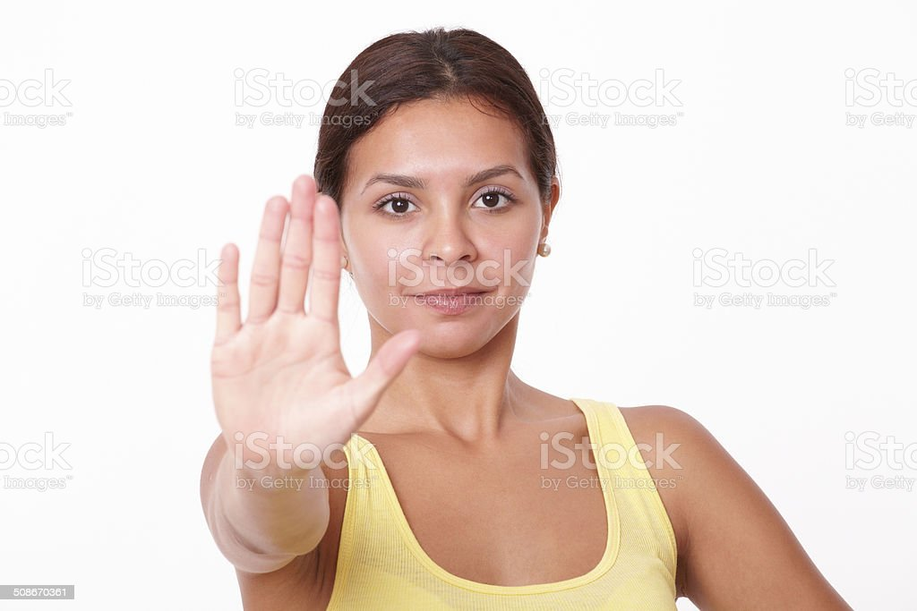 Young hispanic lady with stop gesture stock photo