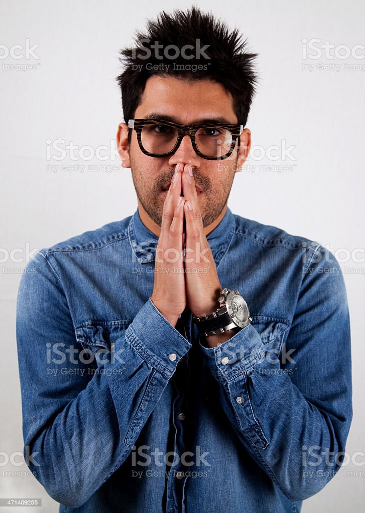 Young Hispanic Man Praying or in deep thought. royalty-free stock photo