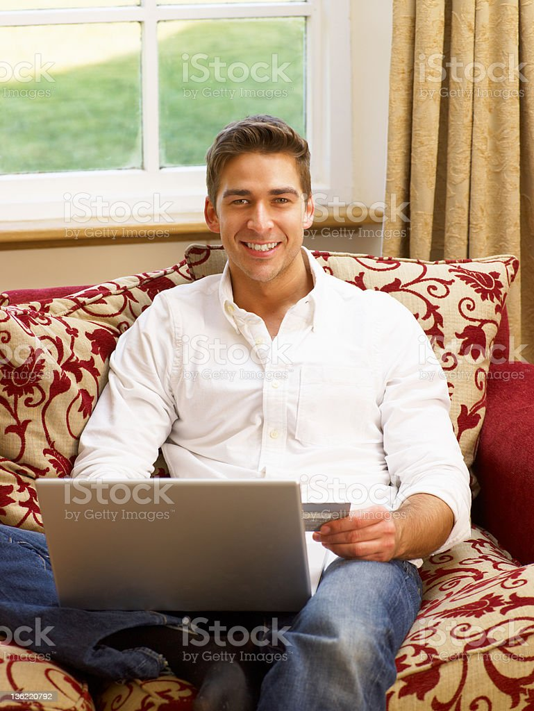 Young Hispanic man shopping online royalty-free stock photo