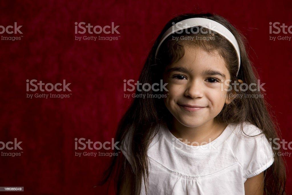 Young Hispanic School Girl Head and Shoulders stock photo