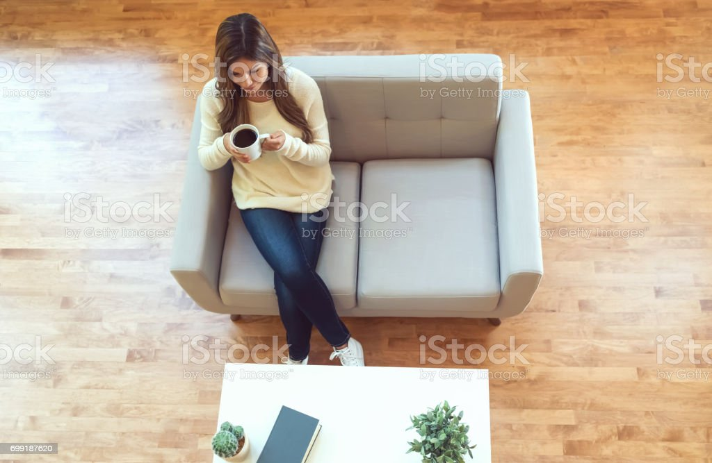 Young hispanic woman drinking coffee stock photo